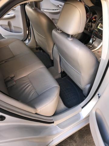 Toyota Corolla xei 13/14 Carro em excelente estado - Foto 16