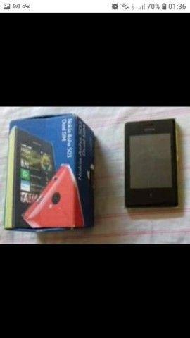 Nokia asha 503(bom estado). Possui caixa, com fone e carregador.<br><br>Valor: 110,00 - Foto 2