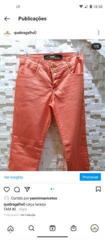 calça laranja tam 40