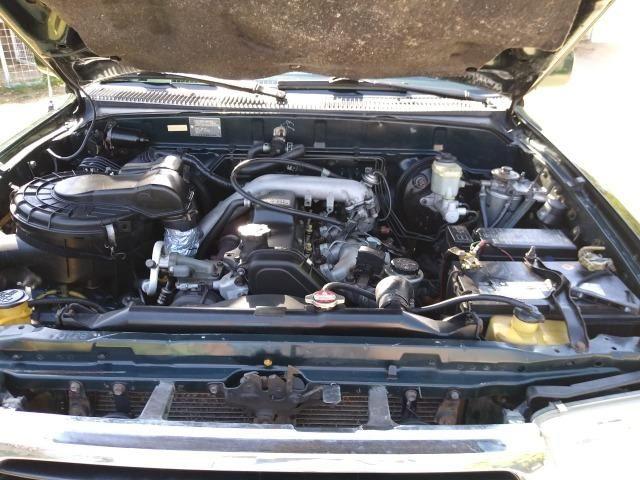 Toyota HIlux SW4 4x4 7 lugares Turbo Diesel - Foto 7