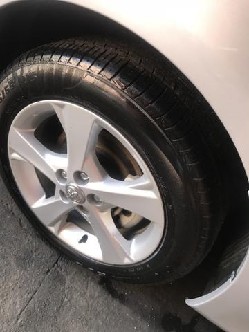 Toyota Corolla xei 13/14 Carro em excelente estado - Foto 6