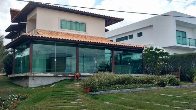 Casa com 4 quartos com varanda em condomínio com piscina aquecida e campo de golf