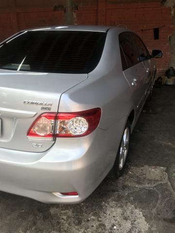 Toyota Corolla xei 13/14 Carro em excelente estado - Foto 4
