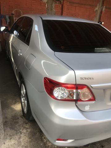 Toyota Corolla xei 13/14 Carro em excelente estado - Foto 3