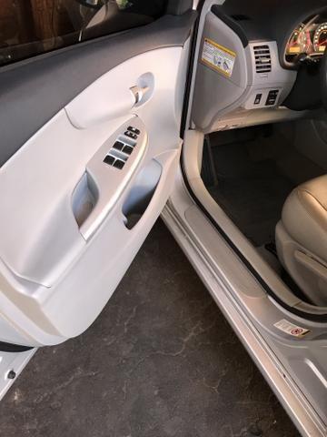 Toyota Corolla xei 13/14 Carro em excelente estado - Foto 11