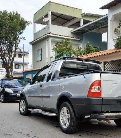 Strada, GNV e banco traseiro