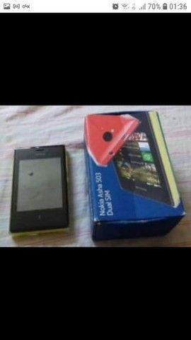 Nokia asha 503(bom estado). Possui caixa, com fone e carregador.<br><br>Valor: 110,00 - Foto 4