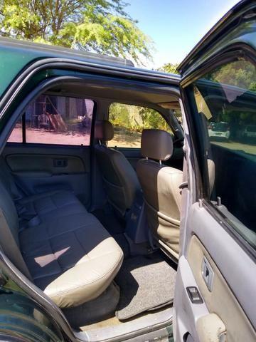 Toyota HIlux SW4 4x4 7 lugares Turbo Diesel - Foto 8