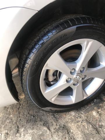 Toyota Corolla xei 13/14 Carro em excelente estado - Foto 5