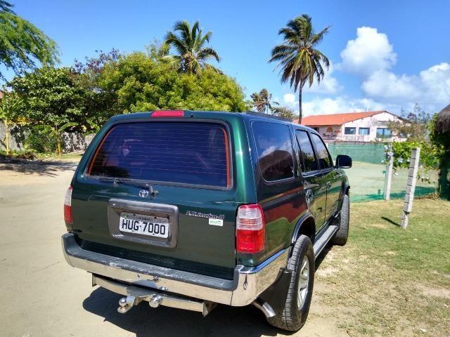 Toyota HIlux SW4 4x4 7 lugares Turbo Diesel - Foto 13