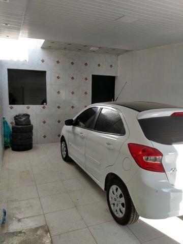 Casa tipo duplex 2 suítes, varandão, garagem coberta com cisterna e quintal Gigante - Foto 13