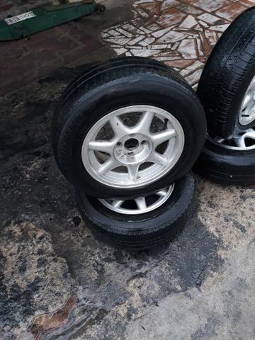 Vendo aros 14 completo 4 pneus meia vida 1000