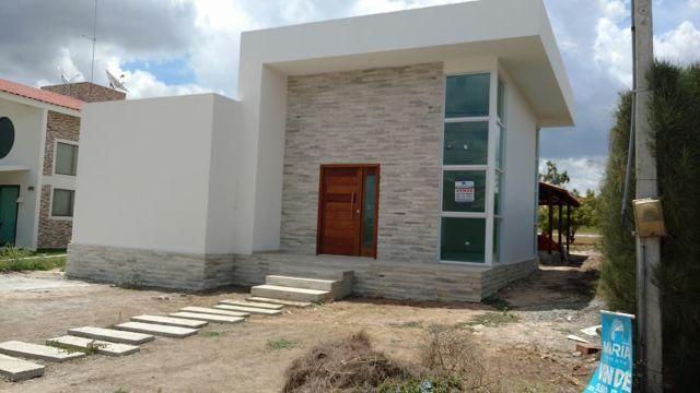 Casa térrea com 4 suítes em condomínio - Terreno com 450 mts Ref.LM5