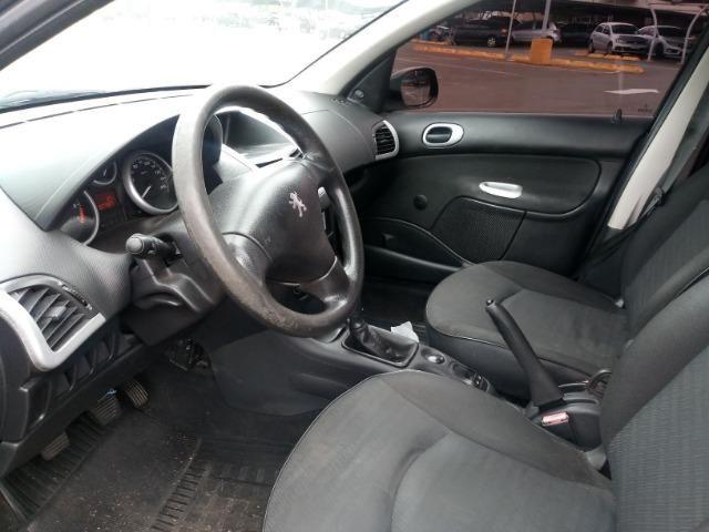 Peugeot 207 1.4 8v Flex 4 portas, Direção Hidraulica e Vidros Eletricos baixa Km - Foto 4