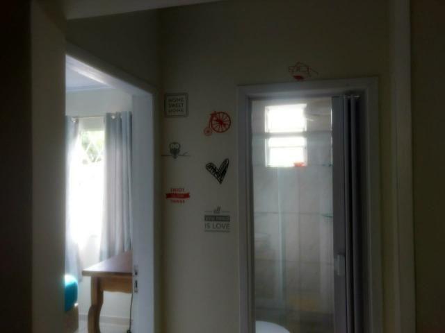 Alugo casa com dois quartos - Foto 4