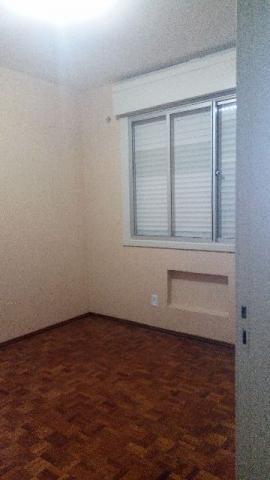 Apartamento central ,dois dormitórios com garagem