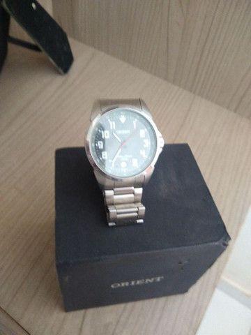 Vendo relógio oriente original na caixa e com nota  - Foto 2