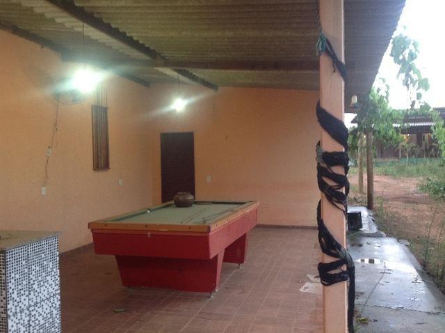 Chácara em caldas toda cercada,casa 3 dormitórios,quiosque,rio pirapitinga,poço de peixe - Foto 8