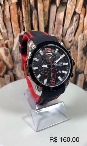 Lindo relógio Megir todo funcional, só chamar e enviar todos os modelos.