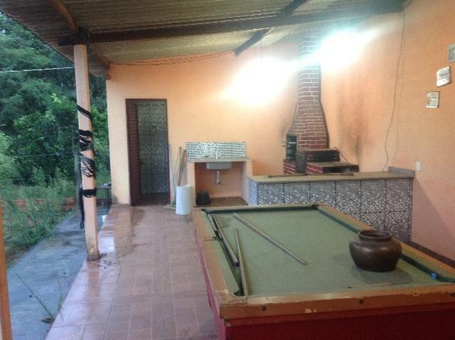 Chácara em caldas toda cercada,casa 3 dormitórios,quiosque,rio pirapitinga,poço de peixe - Foto 14