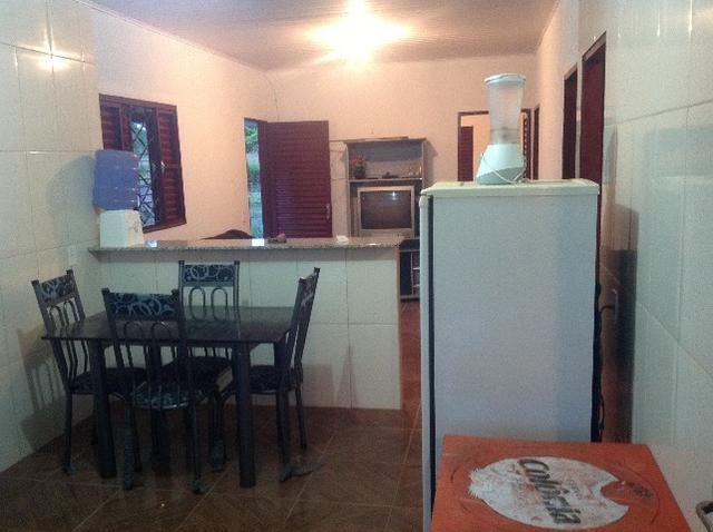 Chácara em caldas toda cercada,casa 3 dormitórios,quiosque,rio pirapitinga,poço de peixe - Foto 18
