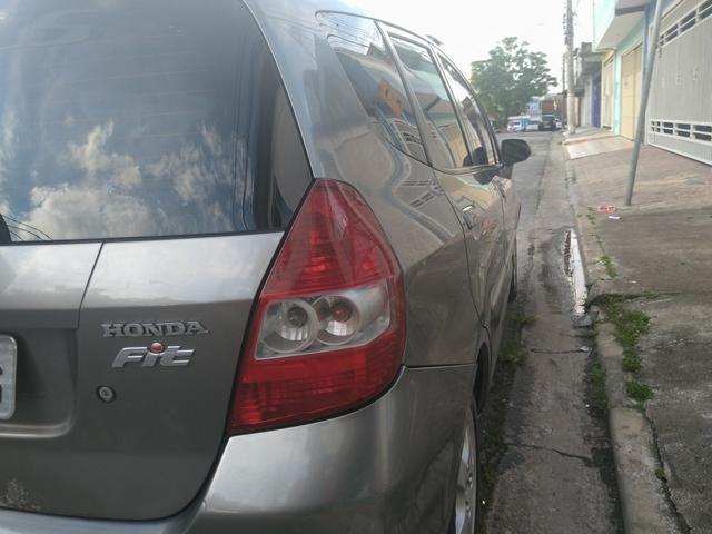 Honda fit 2006 bem abaixo da tabelars 15.000 carro com passagem de leilão