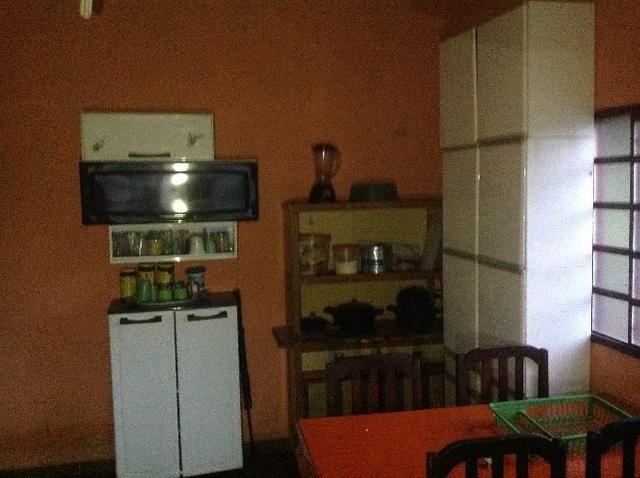 Chácara em caldas toda cercada,casa 3 dormitórios,quiosque,rio pirapitinga,poço de peixe - Foto 12