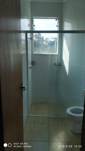 Kitnets com cômodo amplo para dois ambientes (sala e quarto), cozinha com gabinete - Foto 9