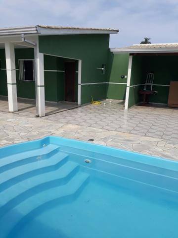 Casa com piscina na praia de leste