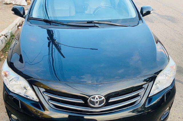 Corolla 2011/2012 cor preto perolizado - Foto 9