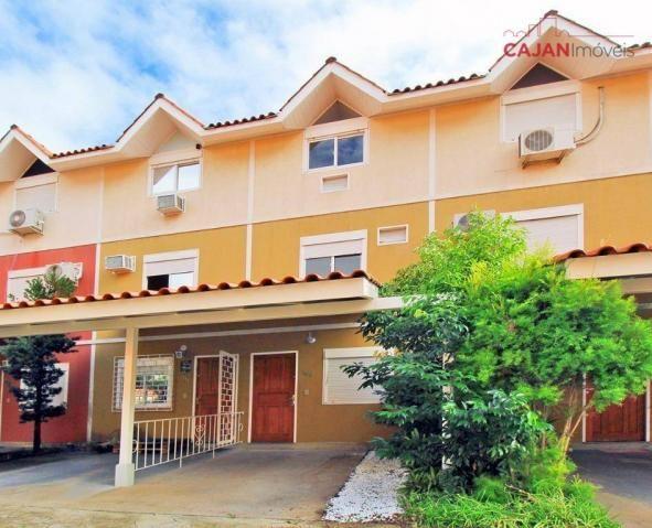 Casa em condomínio com 3 dormitórios e 1 vaga no bairro camaquã