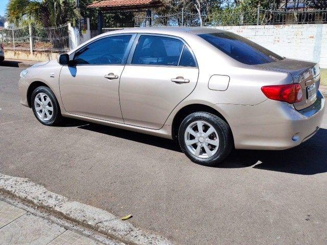 Corola  1.6 Automático  2009  ótima conservação  - Foto 12