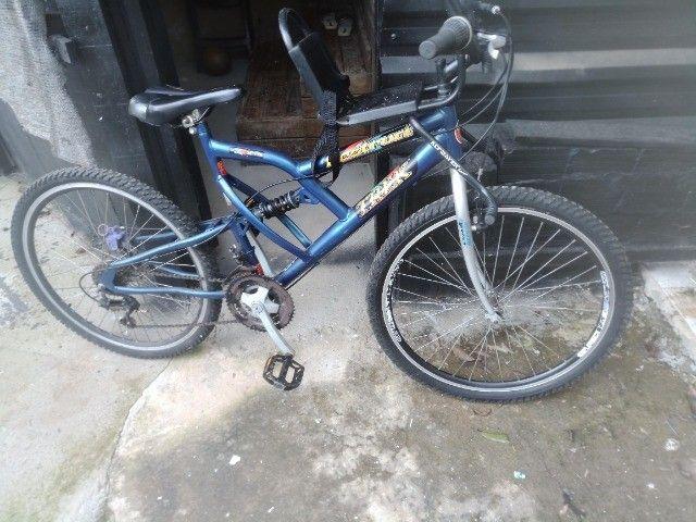 Bicicleta com suporte para criancas freio a disco - Foto 3