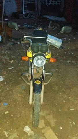 Vendo uma moto honda cg fan ks, ano 2010,cor amarelo