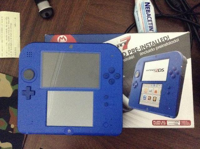 Nintendo 2ds na caixa, desbl com cartao de 32 gb de jogos