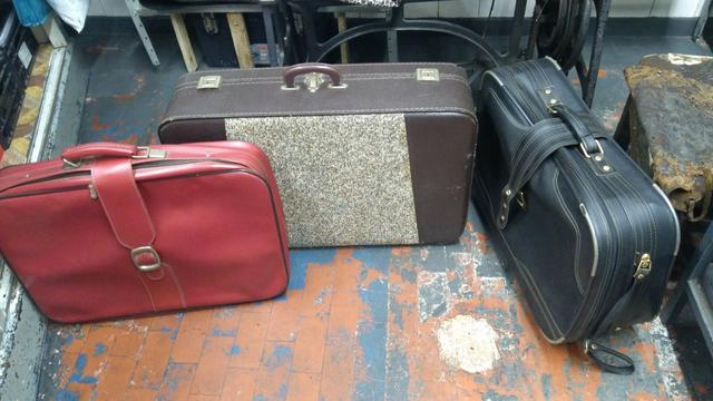 Três malas antigas