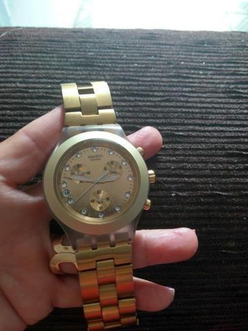 df47d7da530 Vendo relógio original Swatch dourado - Bijouterias