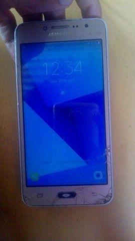 Samsung J2 com trinco que n atrapalha em nada