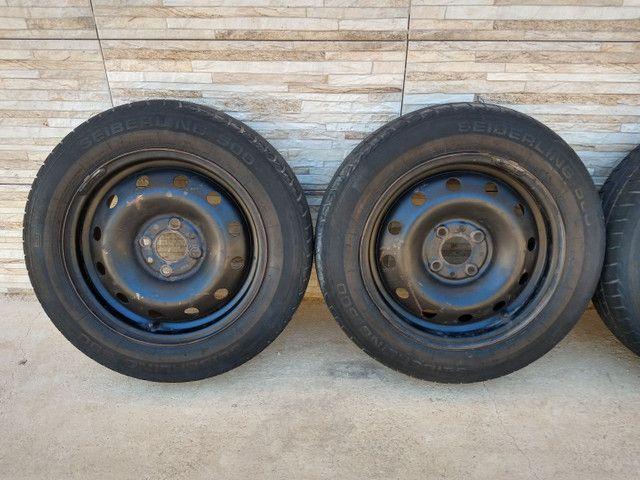 Jogo de rodas 14 de ferro semi novas originais do fiat pálio - Foto 11