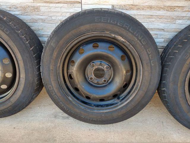 Jogo de rodas 14 de ferro semi novas originais do fiat pálio - Foto 6