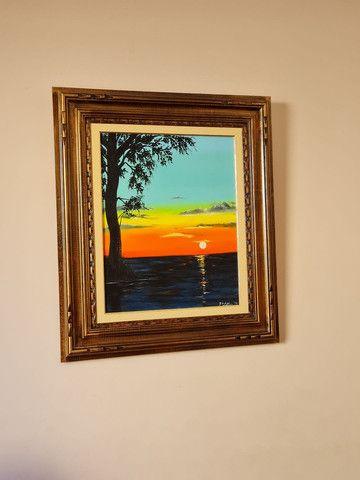 quadro do por do sol com moldura