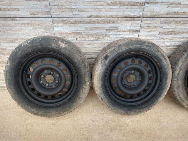 Jogo de rodas 14 de ferro semi novas de furação 4x100 - Foto 11