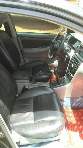 Toyota Corolla 2004 completo