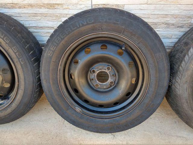 Jogo de rodas 14 de ferro semi novas originais do fiat pálio - Foto 3