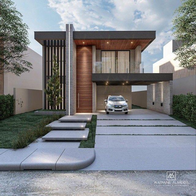 Casa moderna de 5 quartos sendo 2 suítes no condomínio Terras Alphaville.