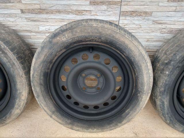 Jogo de rodas 14 de ferro semi novas de furação 4x100 - Foto 5