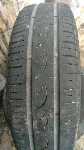 Vendo 4 pneus 14 seminovos e 2 meia vida - Foto 2
