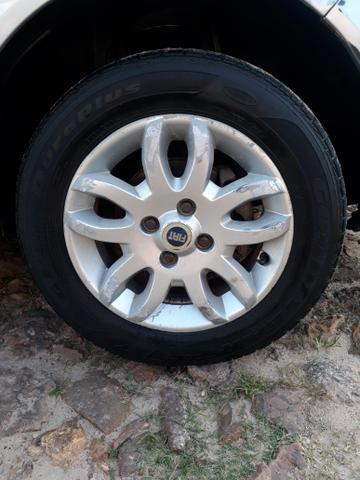 Vendo essas rodas aro 14/ ou troco por rodas de ferro com volta pra mim.