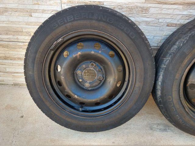 Jogo de rodas 14 de ferro semi novas originais do fiat pálio - Foto 5