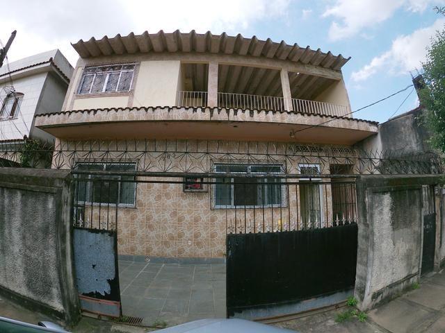 Terreno de 250m2 com 3 casas e quintal em Jardim América - Rio de Janeiro